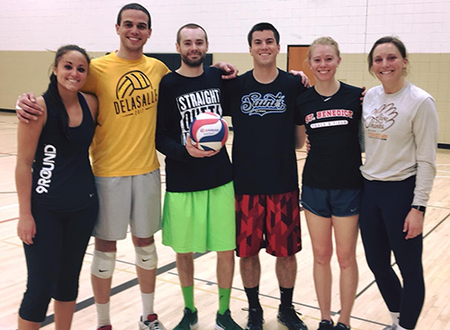 indoor volleyball team with men and women