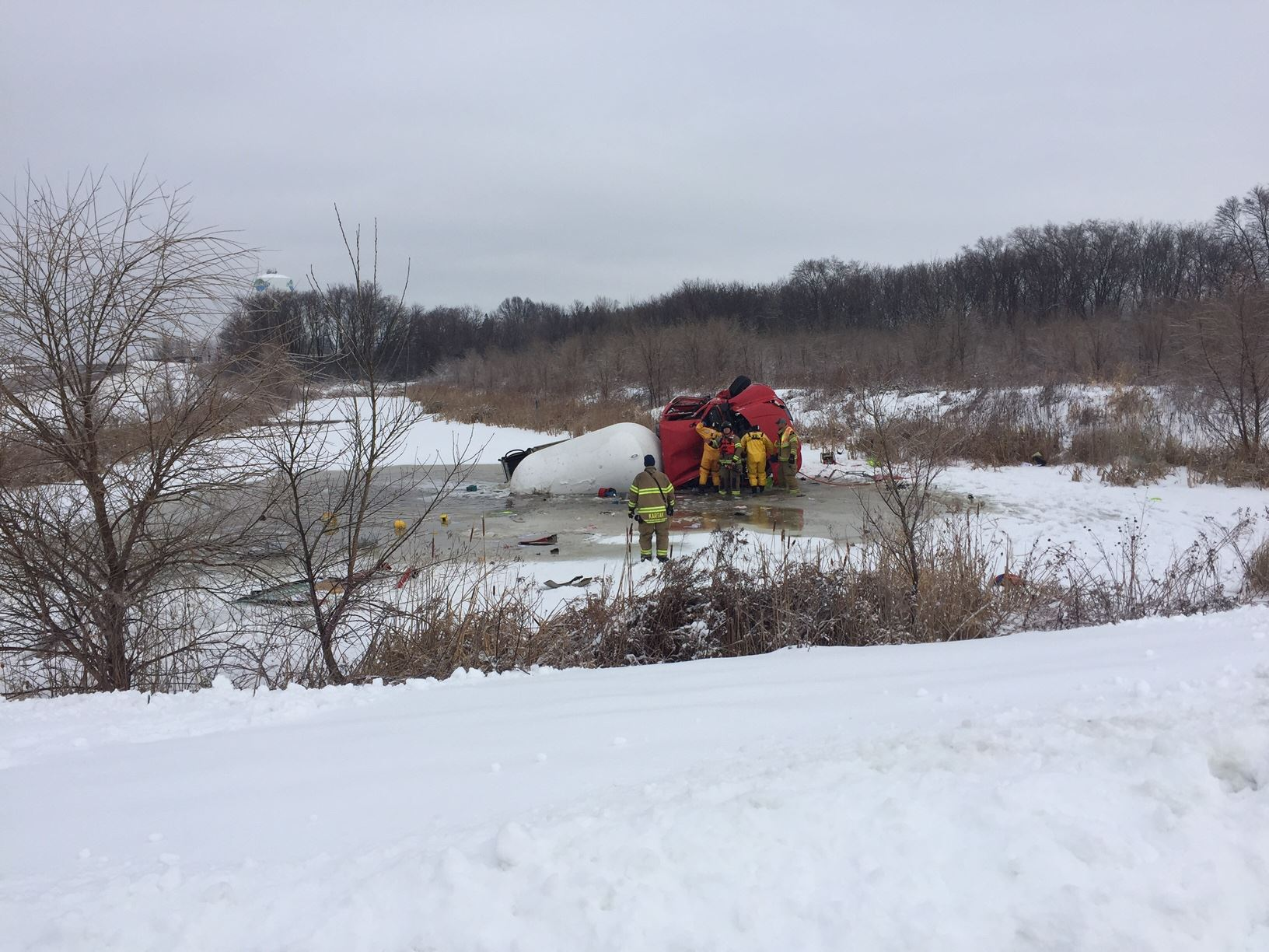 Propane truck in holding pond